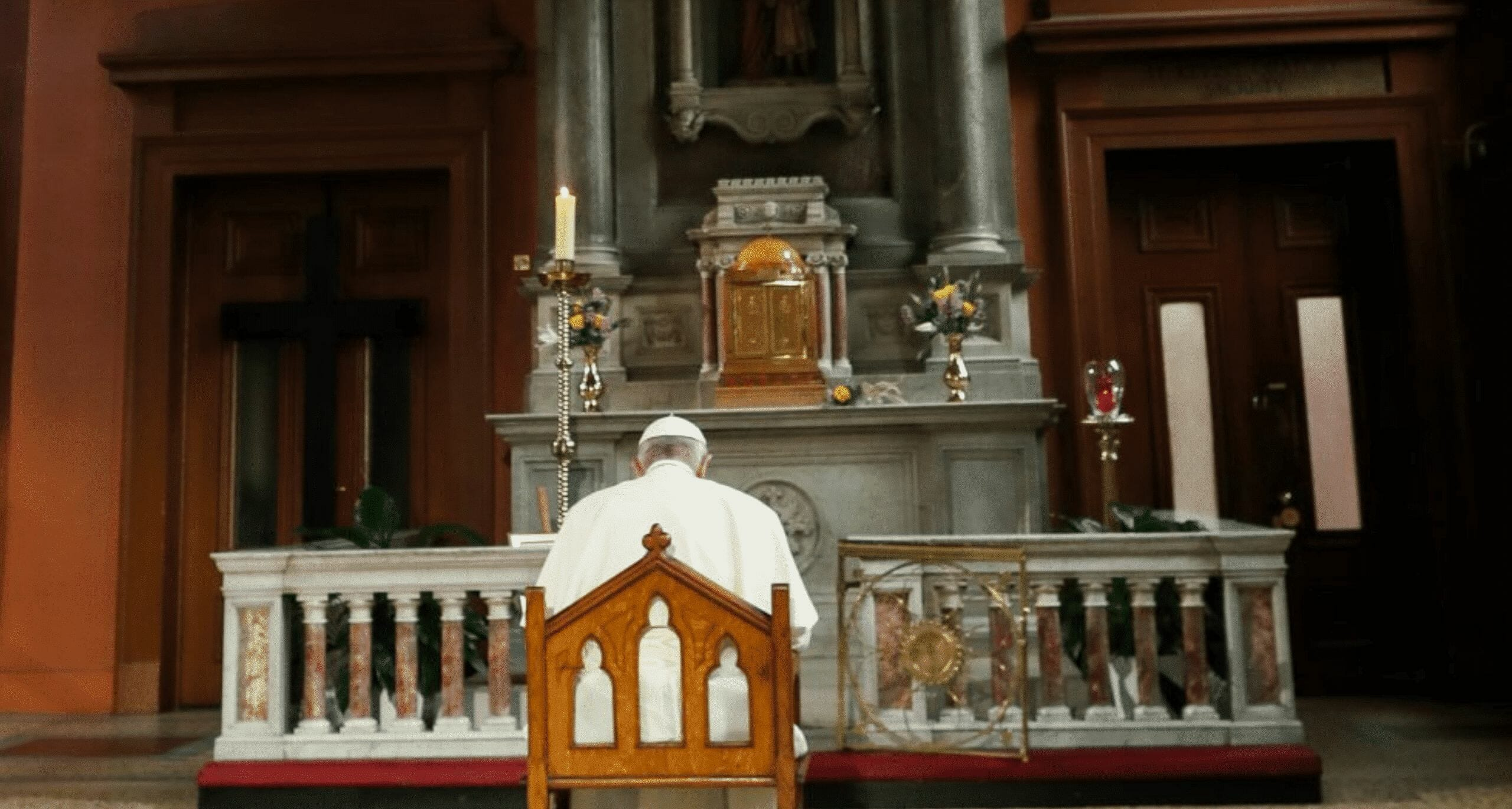 Pope Francis prays before a Candle of Atonement in Dublin's St Mary's pro-Cathedral, August 2019